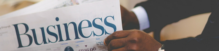 Man holding business newspaper